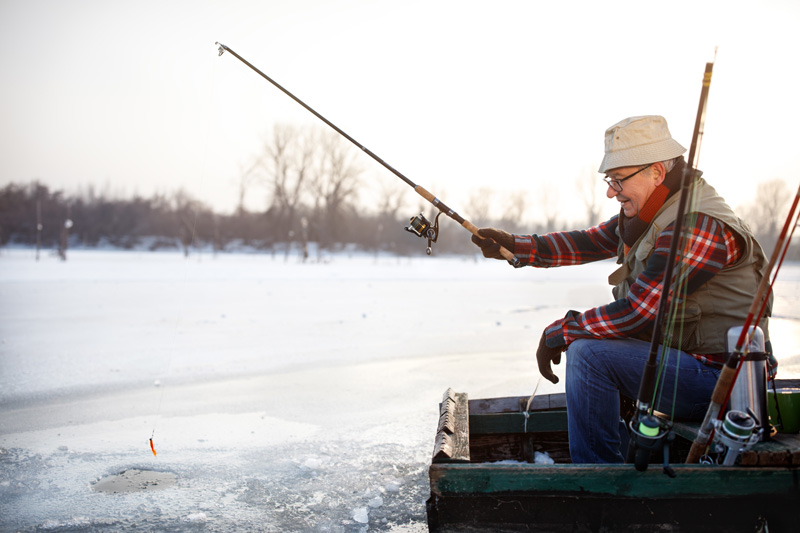 senior ice fishing during the winter